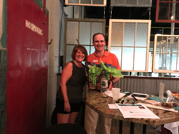 Dwendy-Johnson-presents-door-prize-to-Tom-Boyle-at-Midstate-Distillery.-jpg
